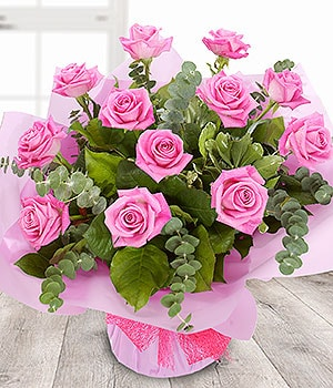 Image of Doze Pink Roses - Valentines Day at Oasis Flowers, Bromsgrove Florist